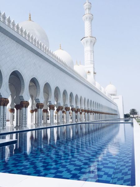 Abu Dhabi Architecture United Arab Emirates Arch Architectural Column Architecture Building Building Exterior Built Structure Clear Sky Day Dome Grand Mosque Nature Outdoors Place Of Worship Pool Religion Sheik Zayed Mosque Sky Swimming Pool Tourism Travel Travel Destinations Water
