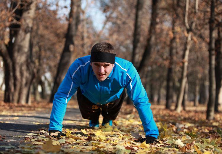 Man exercising at public park