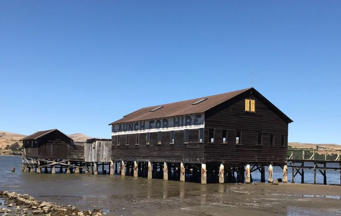 Architecture Built Structure Water Building Exterior Clear Sky Outdoors Day Beach Stilt House No People Blue Sea Sky Nature Inverness, Calif Marin County CA Weathered Pt. Reyes National Seashore Architecture Wood - Material Building