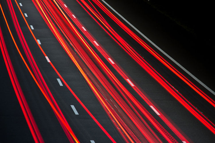 Heavy Traffic Abstract Black Background Exposure Illuminated Light Trail Multi Colored Night No People Outdoors Red Road Speed