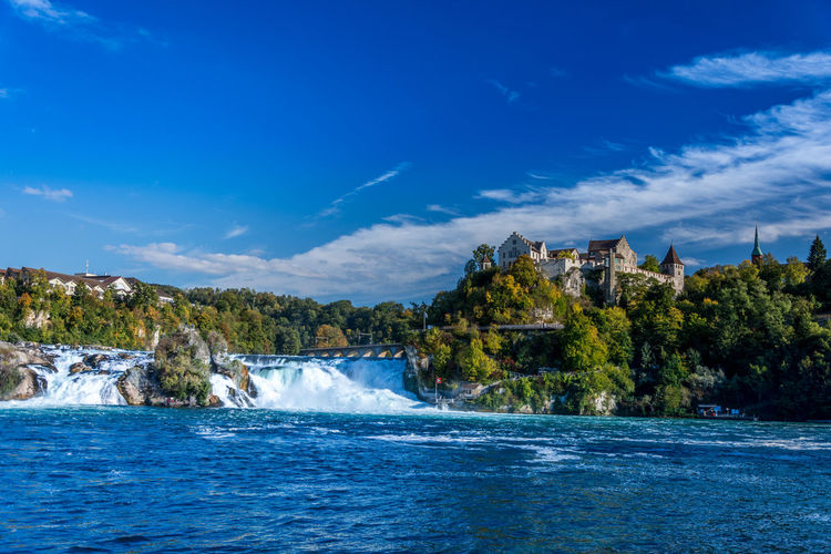 Idyllic view of rhine falls against sky