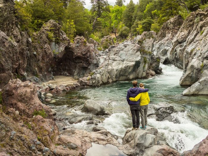Travel moment: a hug after a long hike in a gorge in the Siete Tazas region, Chile. Purple Yellow Siete Tazas Chile Calm Tranquility Scenery Exploring Adventure Hug Couple Wildwater Hiking Rock - Object Waterfall Adventure Mountain People Scenics Beauty In Nature RISK Nature Outdoors River Rock Climbing Journey Full Length An Eye For Travel EyeEmNewHere Shades Of Winter