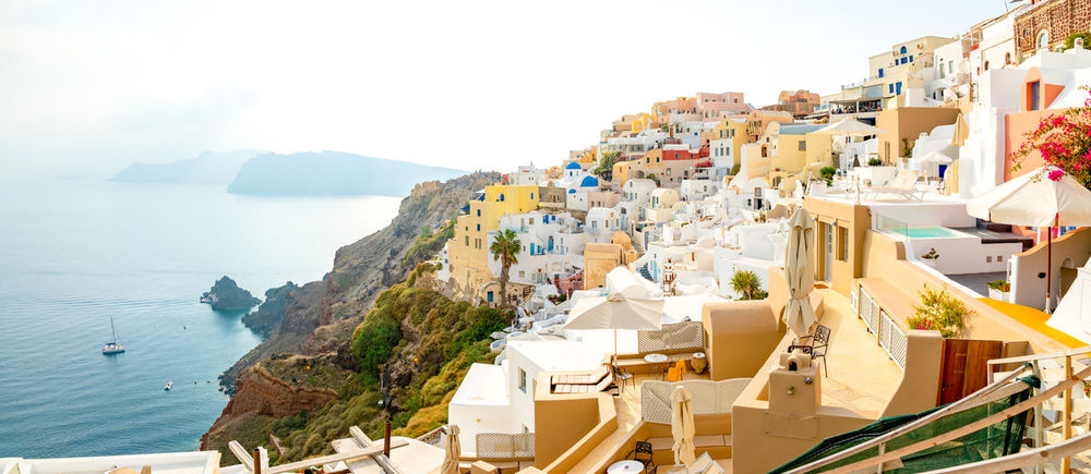 Greece Santorini Oia Thira Water Sea Architecture Sky Building Exterior Mountain Nature Built Structure Building Day Land High Angle View No People City Travel Destinations Beach Residential District Scenics - Nature Panoramic TOWNSCAPE