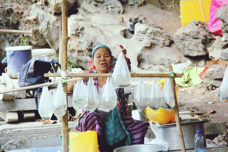 Only Women Adult Adults Only One Woman Only Business Finance And Industry People One Person Sitting Women Day Portrait Outdoors Human Hand One Young Woman Only Selling On The Street Selling Fish Myanmar