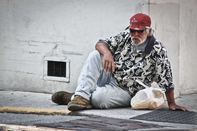 Full length of man sitting on floor