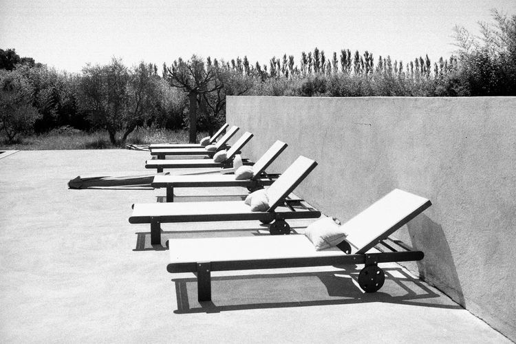 35mm Film Analogue Photography Deckchairs France Absence Analog Beauty In Nature Blackandwhite Clear Sky Day Empty Landscape Luberon Nature No People Outdoors Pool Poolside Sky Summer Tranquility Tree