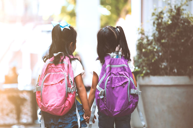 Two cute asian child girls with backpack eating pancake together after school in the school Accessory Adorable Asian  Back Backpack Bag Brotherhood Cheerful Child Curious Cute Daughter Development Education Elementary Enjoy Environment Equipment Family Friend Fun Generation Girl Happy Hold Kid Knowledge Learn Lifestyle Love Nature Outdoor People Play Portrait Primary Pupil Run School SchoolGirl Sibling Sister Student Study Talk Thai Together Twin Walk Young