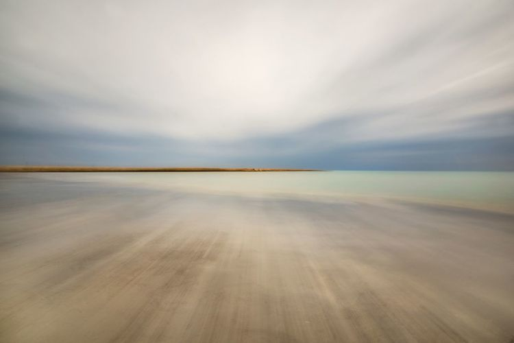Empty beach against sky