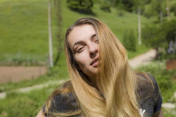 Hair Long Hair Hairstyle Portrait Blond Hair One Person Lifestyles Real People Young Adult Headshot Focus On Foreground Leisure Activity Young Women Land Plant Front View Day Nature Field Outdoors Teenager Beautiful Woman