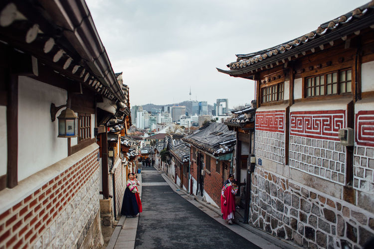 Bukchon Hanok Village, Seoul, Korea Architecture Building Building Exterior Built Structure Bukchon City City Life Classic Day Diminishing Perspective Girls Hanbok Hanok House Incidental People Korea Korean Palace Seoul Sky Street Traditional Travel Destinations Village Walking