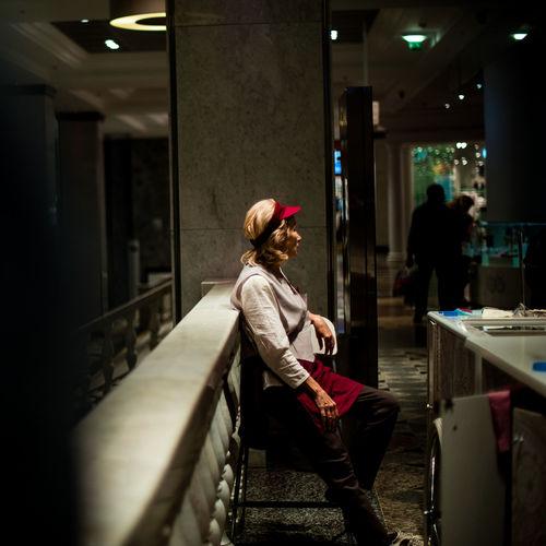 Woman in corridor of building