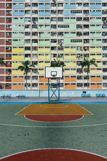 Basketball hoop against buildings in city
