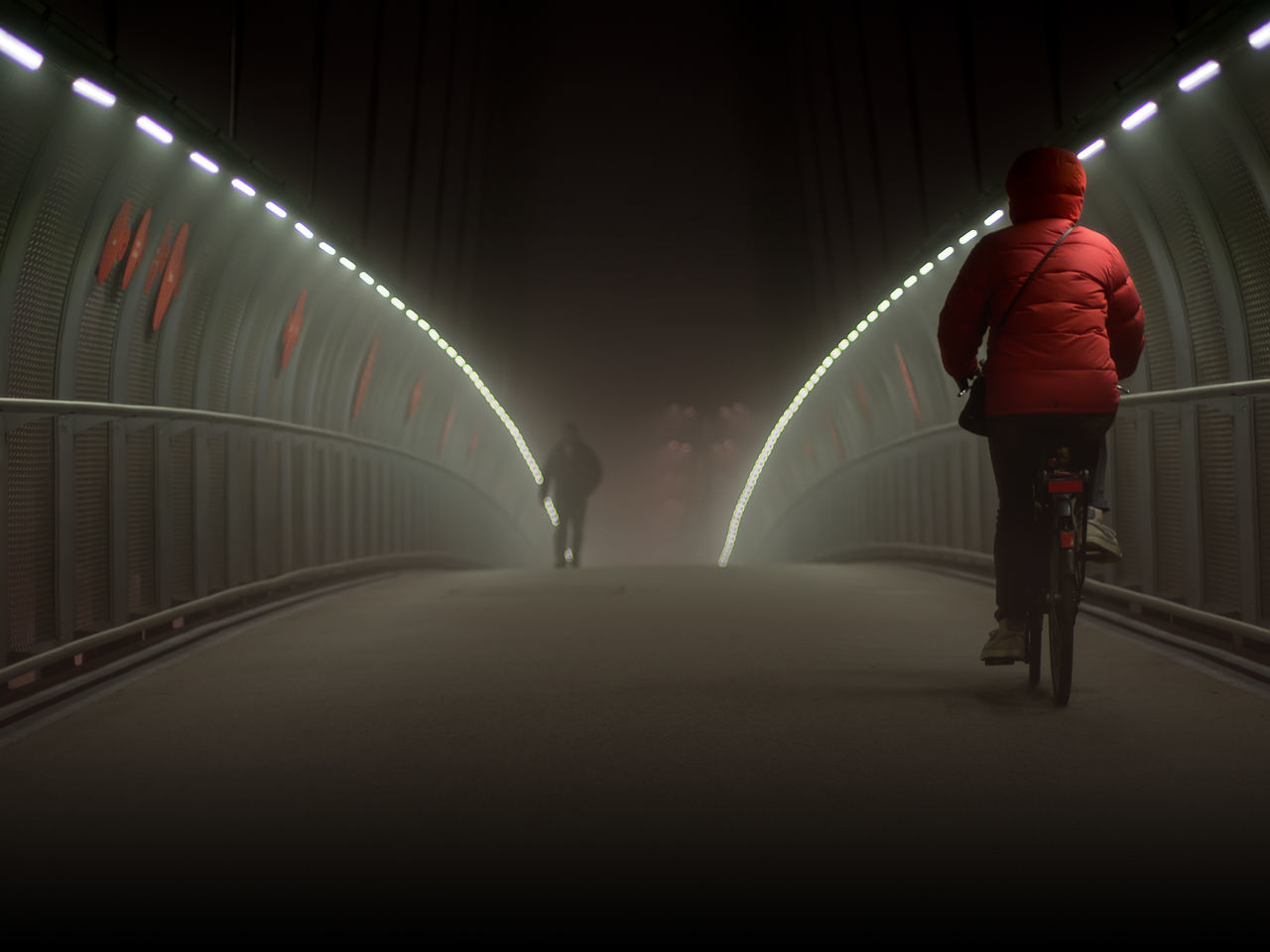 View Of Man In Illuminated Tunnel