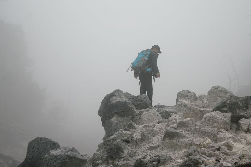 No matter what, keep on moving Gunung Salak Kawah Ratu Kawah Mati Adventure Mountain Rock - Object Hiking Backpack Real People Low Angle View One Person Climbing Exploration Nature Lifestyles Fog