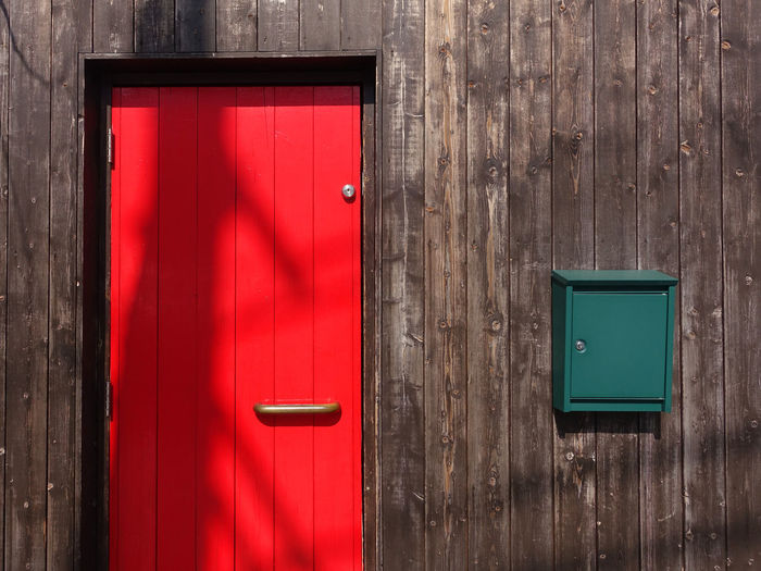 red door and green post box Colors Exterior Built Structure Close-up Day Door Fire Alarm Metal No People Outdoors Post Box  Protection Red Safety Wood - Material The Architect - 2018 EyeEm Awards