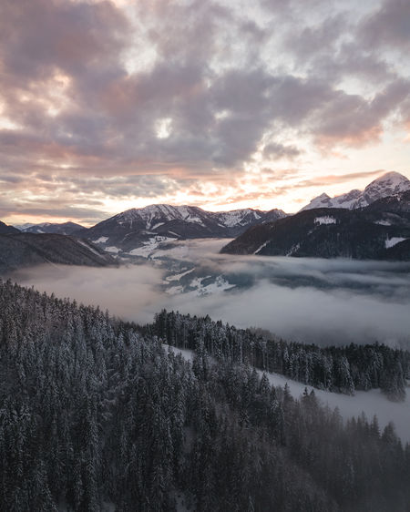 Sunset over the clouds with a beautiful mountain view in Austria captured with a drone. My Best Photo Mountain Sky Scenics - Nature Beauty In Nature Cloud - Sky Tranquil Scene Tranquility Winter Cold Temperature Snow Mountain Range Environment Nature No People Non-urban Scene Landscape Snowcapped Mountain Sun Sunset Drone  Above Clouds Clouds Droneshot Mountain View