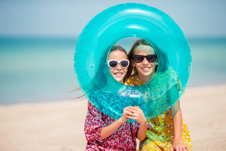 Portrait of happy man wearing sunglasses at beach