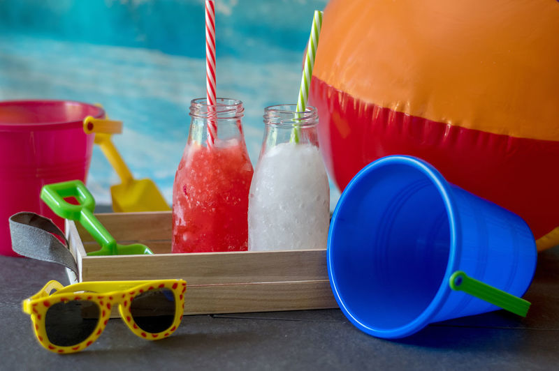 Frozen lemonade and strawberry slushies for kids, a great hit at the beach on a hot summer's day
