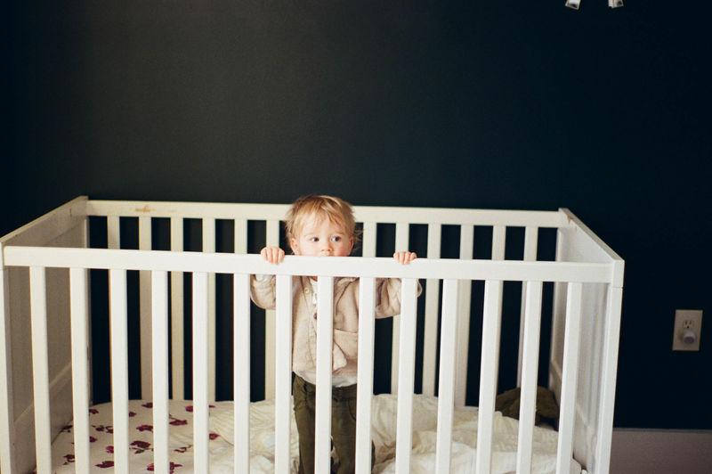 Portrait of boy standing on railing