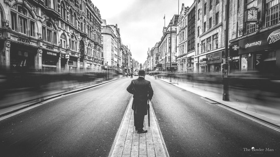 The Bowler Man stands in Oxford Street as London rushes on by. Thebowlerman London Black And White Check This Out Taking Photos Long Exposure England Monochrome City Landscape