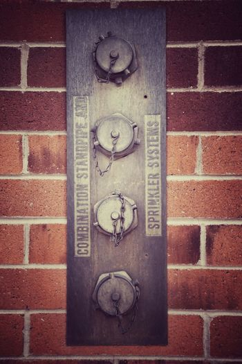 Brick Wall Sprinkler System Stand Pipe Water Hydrants