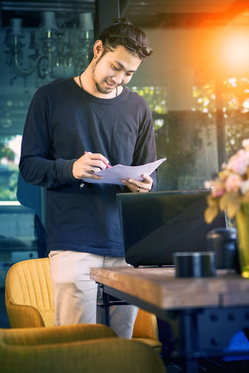 freelance man working in home office Freelance Life Freelance Freelance Work Freelancing Man Men Males  People Portrait Asian  Young Adult Young Younger Young Men Work Working Job Office Lifestyles Smart Home Office Write Read Reading Happy