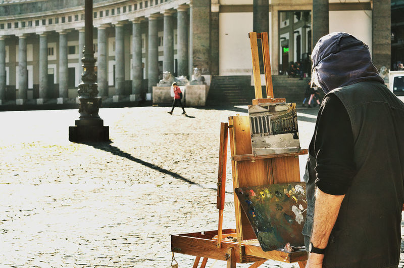 Man Painting At Town Square