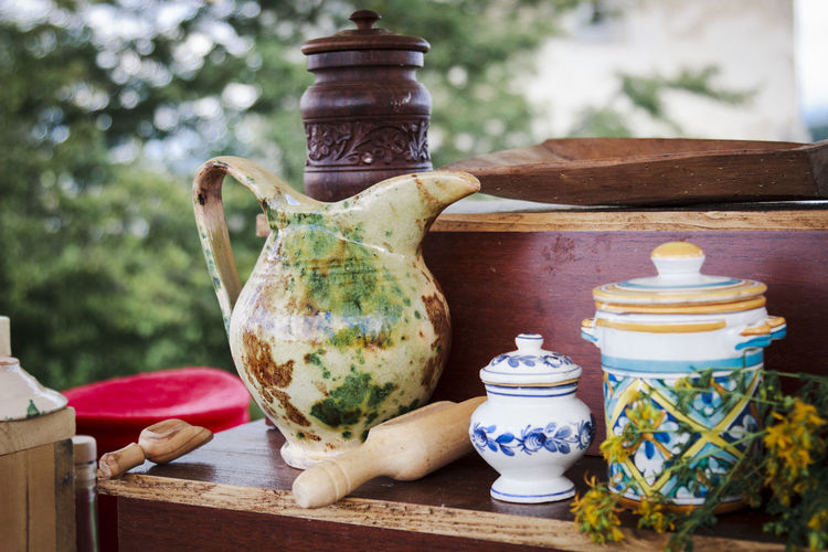 Herb Antique Clay Close-up Container Day Flower Focus On Foreground Food Freshness Healthy Eating Healthy Lifestyle Healty Herbal Herbal Medicine Jar No People Outdoors Pottery Preparation  Seasoning Spice Spices Table Wood - Material