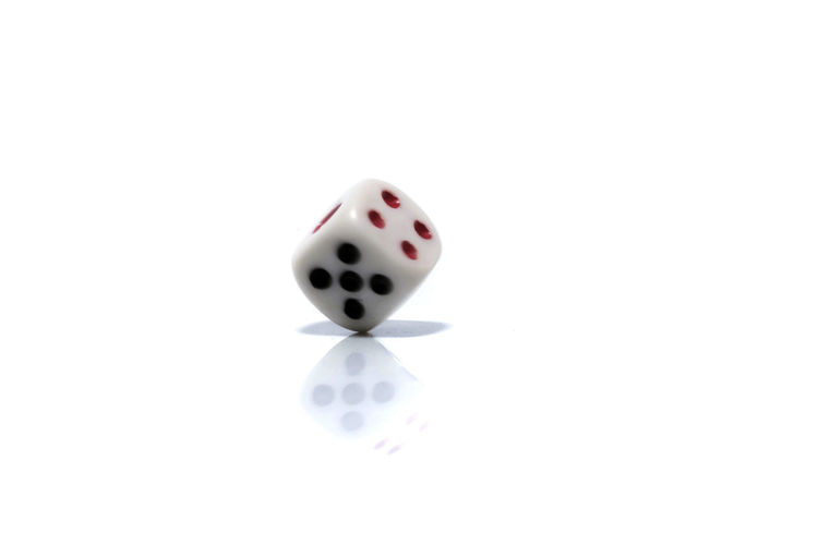 Rolling White dice isolated on white background Arts Culture And Entertainment Copy Space Cube Shape Cut Out Dice Gambling Game Of Chance High Angle View Indoors  Leisure Activity Leisure Games Luck No People Number Opportunity Relaxation Sport Spotted Studio Shot White Background White Color