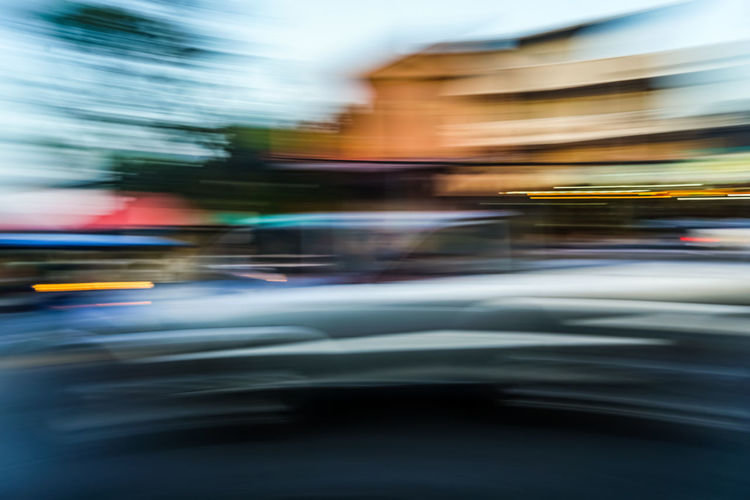 Blurred motion of car on road in city
