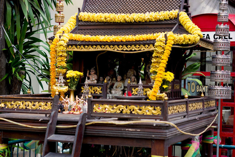 Colorful spirit house in Pattaya city, Thailand ASIA Asian  Pattaya Spirit House Thai Thailand Tradition Wood Art And Craft Belief Buddhism Buddhist Temple Culture Floral Garland Flower Joss House Offering Place Of Worship Religion Representation Sculpture Shrine Spirituality Traditional