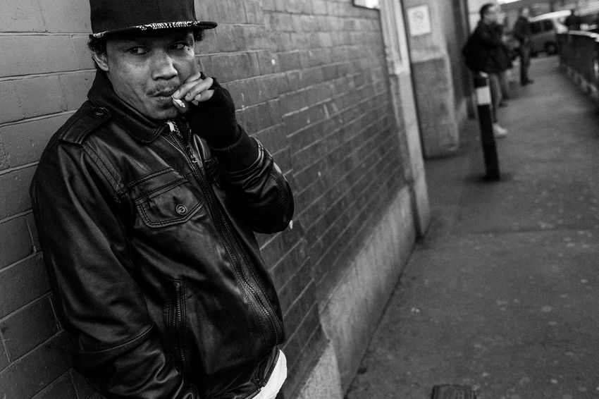 A young male enjoys a smoke watching the world go by outside Waterloo Station, London Dude London Smoking Waterloo Adult Black And White Cigarette  City Day Leather Jacket Monochrome Monochrome Photography One Man Only One Person Outdoors People Real People Street Street Photography Streetphoto_bw Streetphotography Young Adult
