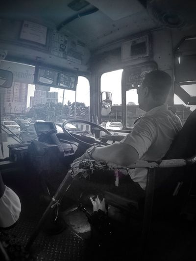 Look forward and driving though Asianlifestyle Man Bangkok Thailand. Traffic Jam Bus Driver Drivers Seat Mode Of Transportation Transportation Sitting Vehicle Interior Real People Indoors  Window Car Day Transparent Glass - Material Men Adult Lifestyles Seat