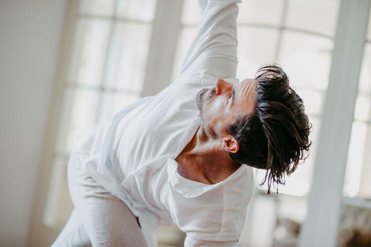 Young man dancing on hardwood floor