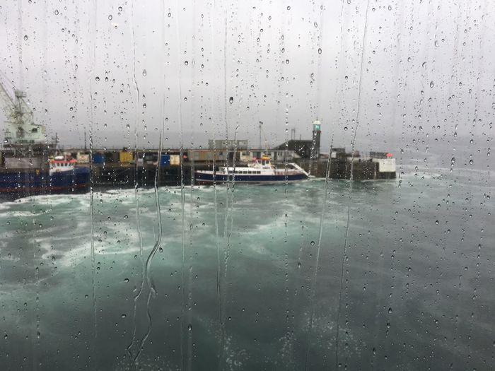 Torrential rain pouring down the ferry window with the view of Saint Peter Port in Guernsey Atlantic Boats Channel Island Harbour Channel Islands Day Drop Guernsey Nature Ocean Port Rain RainDrop Rainy Season Saint Peter Port Sea Seascape Seaside Season  Sky Stormy Weather Through Glass Water Weather Wet Window First Eyeem Photo