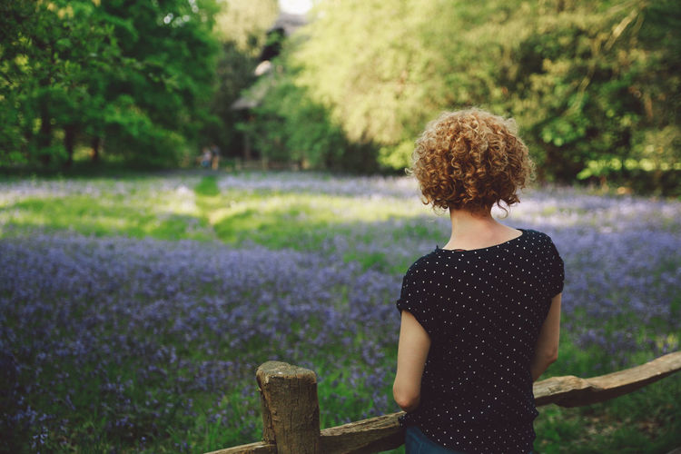 Beauty In Nature Blonde Bluebells Casual Clothing Curly Hair Day Focus On Foreground Girl Grass Growth Leisure Activity Lifestyles Nature Nature Outdoors Park Plant Selective Focus Spring Tranquility Tree Summer Exploratorium