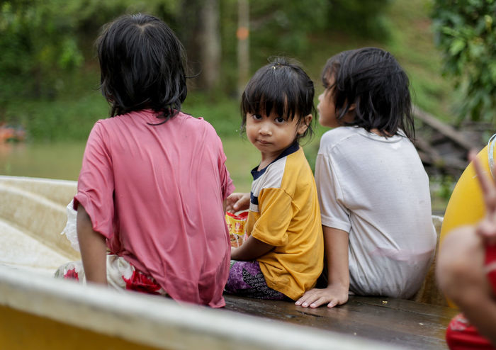 flood victims at kelantan Flood Victim Boys Casual Clothing Childhood Day Elementary Age Flood Full Length Girls Kelantan Leisure Activity Lifestyles Malaysia Outdoors People Real People Togetherness Tree