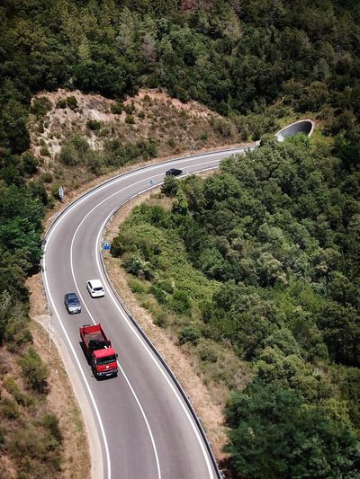 Catalugna roads over mountains Curve Road Small Road Road In Nature Road In The Forest Cars Approaching Road With Cars Country Road Road Curve Rocky Landscape Rocky Land Catalugna Transportation Road Plant High Angle View Tree Mode Of Transportation Land Vehicle Car Curve Nature Day The Way Forward Direction Land Summer Road Tripping