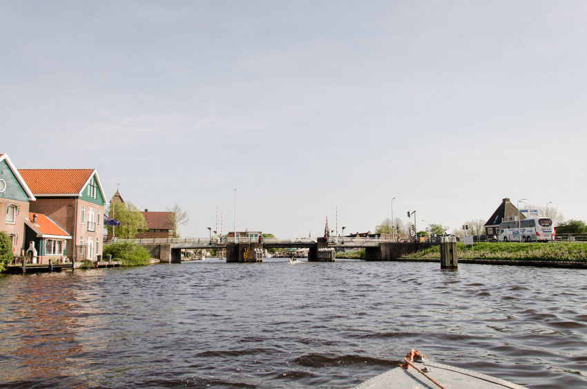 Amstel, Amsterdam, Netherlands. View from the canal on a boat of the Old Town and park grounds Amstel Amsterdam Amsterdam Canal Netherlands Boat Boatinglife Oude Kerk River View From Boat Water