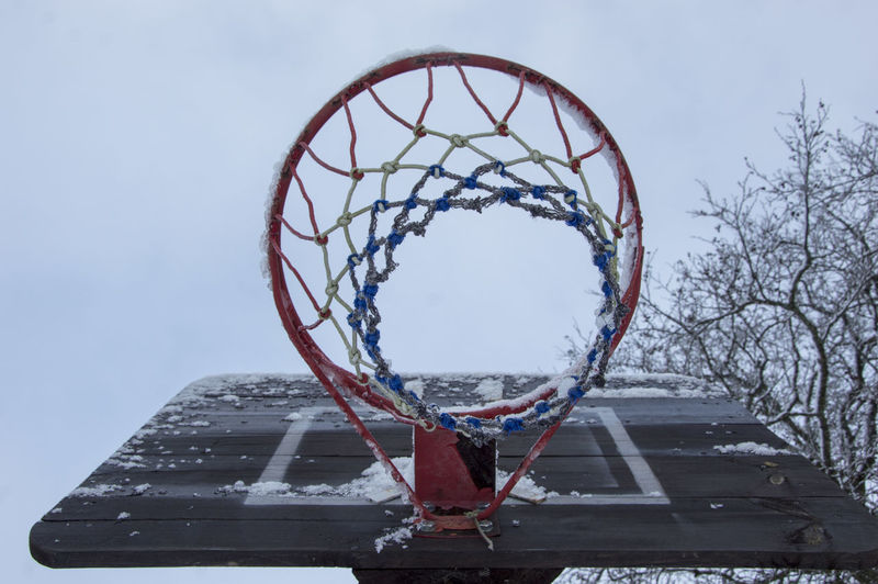 basketball board. Sports Equipment Basketball Basketball - Sport Basketball Board Basketball Board Ring Broken Dunk Dunked On Dilapidated Basketball Game Basketball Hoop Clear Sky Cold Cold Temperature From The Bottom Horizontal Ice Low Angle View Net - Sports Equipment No People Outdoors Sky Snow Sport Sports Photography Winter Winter Sports Basketball Court Wintertime