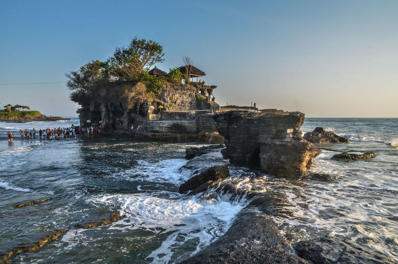 Tanah lot by sea against sky