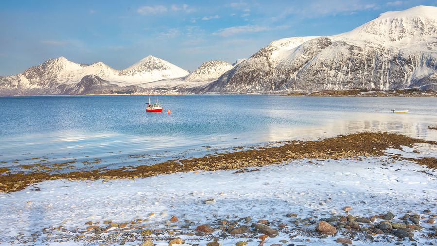 Scenic view at Sommarøy Landscape Arctic Calmness Beauty In Nature Cloud - Sky Cold Temperature Fjord Inflatable  Mode Of Transportation Mountain Nature Nautical Vessel No People Non-urban Scene Outdoors Scenics - Nature Sea Sky Snowcapped Mountain Tranquil Scene Tranquility Transportation Water Waterfront Winter
