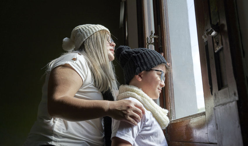 Mother and son look in window