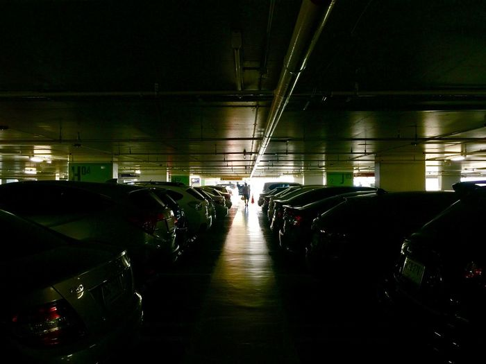 Light in car park Illuminated Lighting Equipment Indoors  Architecture Night Transportation Real People Electric Light Dark Silhouette Ceiling Built Structure Mode Of Transportation Light Light - Natural Phenomenon Public Transportation Travel