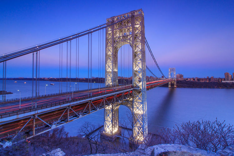 Wide Angle View Of Illuminated Bridge Against Sky