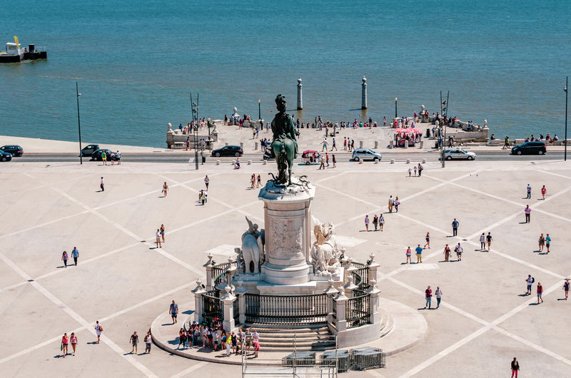 High angle view of people by statue