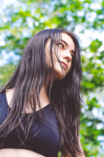 Beautiful girl long hair Adult Beautiful Woman Beauty Black Hair Contemplation Day Focus On Foreground Hair Hairstyle Headshot Leisure Activity Lifestyles Long Hair One Person Outdoors Portrait Real People Teenager Tree Women Young Adult Young Women