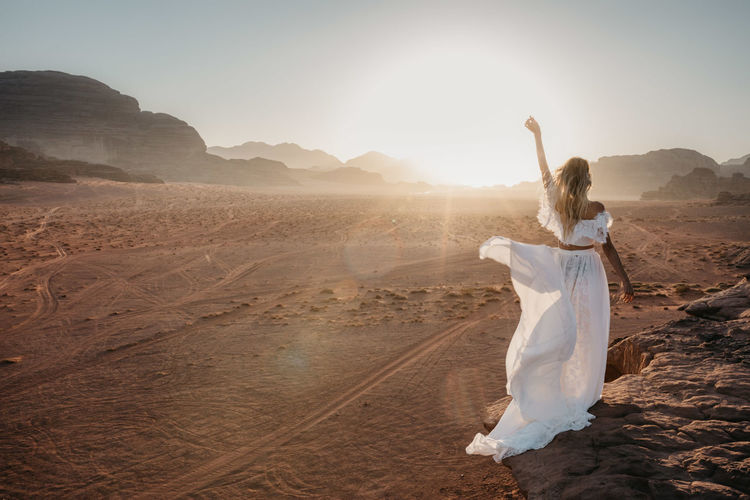 Desert Dreaming Dress Enjoying The View Freedom Jordan Nature RunAway Bride  Stunning Travel Wadi Rum Wanderlust White Dress Woman Bride Desert Beauty Desert Landscape Enjoying Life Golden Hour Portrait Runaway Sunrise Sunset Travel Destinations Woman Portrait