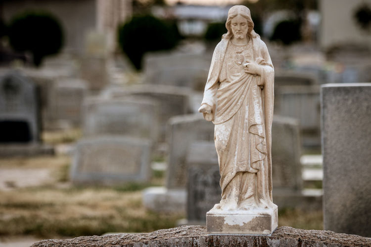 Human Representation Sculpture Representation Grave Statue Art And Craft Cemetery Religion Stone Tombstone Male Likeness Belief Architecture Memorial Spirituality No People History Female Likeness Stone Material Outdoors Angel