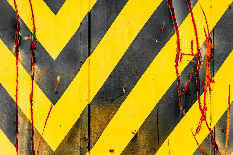 Architecture Backgrounds Black Color Built Structure Close-up Day Full Frame Metal No People Outdoors Paint Pattern Safety Security Sign Striped Sunlight Textured  Wall - Building Feature Yellow